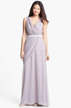 A draped gown from Lela Rose, new to the Wedding Suite!
