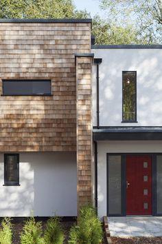 Cedar shingles and smooth white render. Dark aluminium windows, rwps and parapet cappings