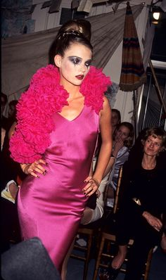 We're rounding up New York Fashion Week's best looks from past runways during our favorite decade: the '90s. Keep reading to see the looks we love.