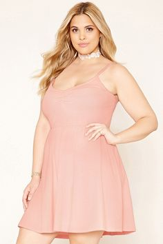 Forever 21+ - A knit skater dress with adjustable cami straps, a subtle V-neckline with ruching, and an elasticized waist.