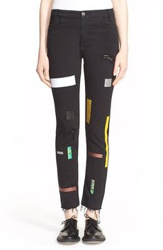 Free shipping and returns on Aries Supertight Taped Slim Leg Jeans at Nordstrom.com. Combining the world of high fashion and hardcore streetwear, Aries creates an elevated denim line with an authentic '90s feel. Black stretch denim is crafted for a supertight fit and the high-rise silhouette is definitely old-school. With a mash-up of glittering and colorful tape and shredded holes, these Italian jeans are ready for your next session.