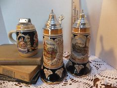 Vintage German Lidded Beer Steins Set of 3. Includes two steins one tabletop Lighter.  by OneRetroLady, $30.00