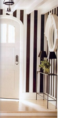 Vertical Black and white stripes, and  arched doorway.