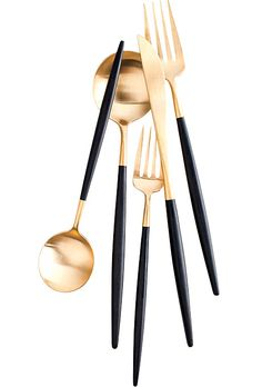 """Petite"" flatware, Gold & laque black - $150 for the five-piece set, DVF Home."