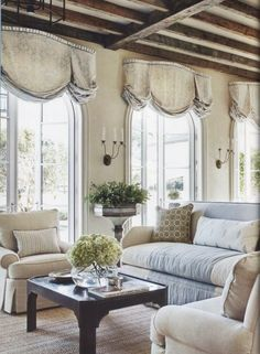 Beautiful window treatments, if they are functional they go well in the room.  dark beams and light room with nice sconces