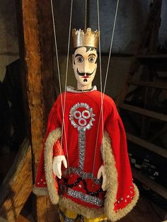 Antique puppets in an amazing scary museum in an ancient attic, in Český…