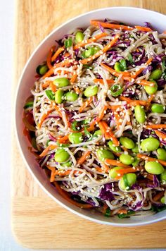Rainbow Soba Noodle Salad - Colorful veggies and chewy soba noodles all tossed together with a flavorful sesame garlic and lime dressing. It's super easy and can be made ahead of time too! (Vegan & GF)   RECIPE at NomingthruLife.com