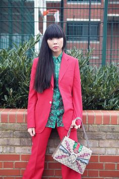 Susie Bubble wearing Gucci Heritage cotton crêpe jacket, matching tailored trousers and green lace shirt with Gucci glitter web trainers with studs and Gucci Dionysus GG Supreme embroidered bag #susielau #stylebubble