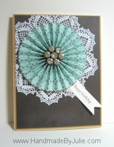 Paper medallion with a vintage rhinestone shank-style button