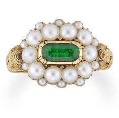 This c.1820 rendering of an oval emerald with pearly circlet (seed pearls set in between the larger natural pearls) were a popular format in Regency and Gregorian times. The ornately carved tapered yellow gold shank beautifully demonstrates the techniques and design choice of this era.  https://www.facebook.com/ganoksin/photos/a.95571724683.85907.95248529683/10154283509954684/?type=3