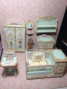 Birthplace of shabby green polychrome wood, drawers in beige, decorated to the oil with floral motifs, gilded reliefs. Quilt and pillow silk hand painted to match the furniture.