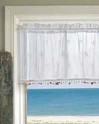 "SAND SHELL STRAIGHT VALANCE - White,   delicate starfish and seashell motifs on crushed lace, accented with shell trim on curtain hems, $32, 45"" x 15""."