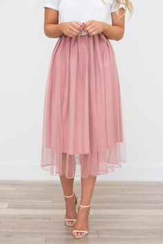 """Midi length tulle skirt. Elastic waist band. Fully lined. Polyester. Hand wash. Measures 29"""""""" long.Model is 5'6"""""""" and wearing a size small. Fits true to size.S (2-4) M (6-8) L (10-12). Style #B02041"""