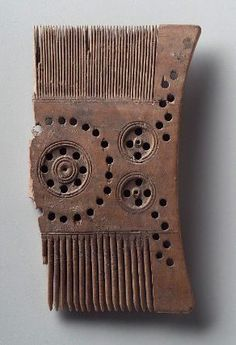 Comb      Egyptian, Byzantine (Coptic) Period, A.D. 364–476   Dimensions      Length x width: 12.5 x 7 cm (4 15/16 x 2 3/4 in.)  Medium or Technique      Wood  Classification      Tools & equipment   Accession Number      14.401