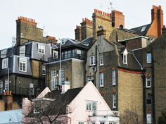 Angular rooftops stacked one upon the other in Chelsea in London's west via Exploring London