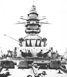 French battleship Strasbourg's imposing superstructure. The design of her quad turrets was such that even when she suffered a 15″ hit on the turret roof during the debacle at Mers-el-Kébir only the right side of the turret was knocked out. The left was able to continue the fight.