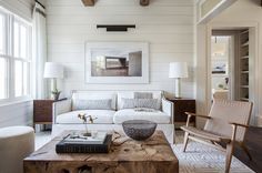 Shiplap and exposed beams with traditional tailored sofa