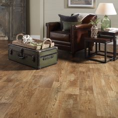 Sheet vinyl - looks like real wood and should hold up in cold weather.  Lowes. STAINMASTER 12-ft W Huntington Coffee Wood Low-Gloss Finish Sheet Vinyl