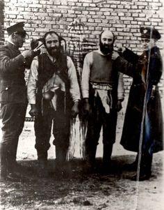 Poland, Two Jews having their beards shorn by German policemen.