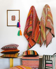 12 Inspiring Ways To Creatively Display Your Textile Collection – Lamour Artisans Textile Market, Home Textile, African Living Rooms, Sunflower Kitchen Decor, Storing Blankets, Batik Art, Southern Living Homes, Ikea Frames, Fabric Art