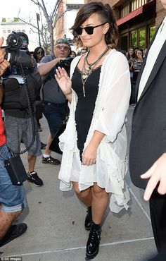 Calm in the storm: Demi Lovato stayed cool and waved to onlookers as she left her New York...