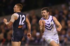 Australian Football League Round 14 Fremantle vs Brisbane Lions  at  Patersons Stadium, on, Saturday, June 21th, 7:40pm (AEST). With matches against sides in the bottom-10 by the following seven rounds, worth Australian Football League, Tv Channels, Brisbane, Lions, Tank Man, June, Running, Lion, Keep Running