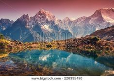 Buy Mountains with snow covered peaks, red sky reflected in lake by den-belitsky on PhotoDune. Beautiful landscape with high mountains with snow covered peaks, red sky reflected in lake. Mountain valley with refl. Mountain Photography, Wildlife Photography, Photos For Sale, Stock Photos, Water Reflections, Himalayan, Asia Travel, Nature Photos, Wedding Invitations