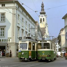 Two trams meet in Annenstraße in Graz, with the Barmherzigenkirche in the background. To the left a two-axle set on route 6 from Sankt Peter to Hauptbahnhof, to the right a Lohner-built articulated tram on route 7 (Wetzelsdorf - Sankt Leonhard) Graz Austria, Rail Europe, Christmas Travel, Light Rail, Public Transport, Good Old, Transportation, Adventure, Pictures