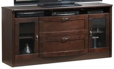 New World. Give your home theatre a stylish new look with the Huxley TV credenza. Substantial and handsome, the design boasts a bowed front and drawers with coordinating curved silver-toned hardware. The glass front cabinets give a clear view to your collectibles, and ample drawer space keeps all your accessories out of sight. Made in Canada.
