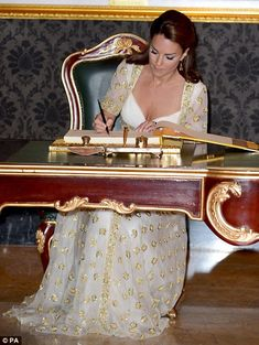 Princess Kate signed the guest book at the Kuala Lumpur gala.