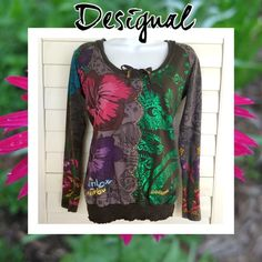 ⚫️ Just In! Desigual Lace Back Top Super cute bright graphic top by Desigual...the back is all dark gray lined lace so it's not see-through...great pre-owned condition except a little of the elastic loosened at the bottom (see picture - can't tell when it's on)...this is one of my favorite brands Bc I just LOVE how quirky and colorful their pieces are!! Size Small Desigual Tops Tees - Long Sleeve