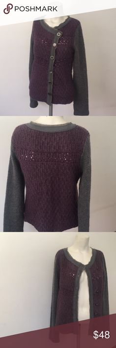 Free People sweater Free People sweater with a beautiful muted gray/purple color.  Cool combo of two different kind of buttons detailing. Different patterns in the yarn design make this sweater really unique. Free People Sweaters