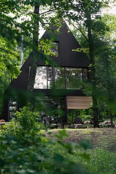 Impeccable Black Cottage in Quebec Forest by Jean Verville