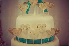 """""""It's a boy"""" hearts decorating a baby shower cake"""