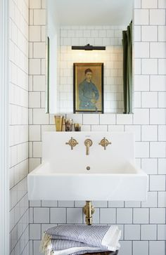 Bathroom of House & Home art director Mandy Milks. Wall-mounted sink from Duravit. Kohler faucet.