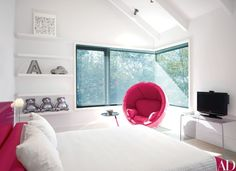 In a children's bedroom, an Inmod chair and a metal Ligne Roset side table add playful modern notes | archdigest.com