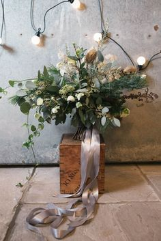 Hand picked Flowers & Foliage Bouquet with Ribbon | Festoon Lights | Image by Fiona Higgins | http://www.rockmywedding.co.uk/rainy-wedding-day-solutions/