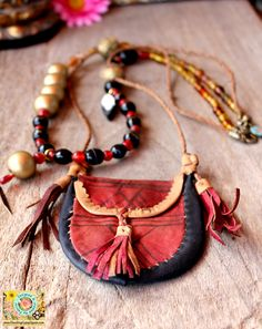 Gypsy Ibiza style Bohemian leather statement necklace in Gold and Red with Red leather small bag - African jewelry & Bohemian jewelry. €129.95, via Etsy.
