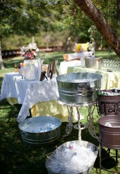 our favorite way to keep drinks cold at wedding receptions is with over-sized galvanized tubs and tons of ice. Whether you're chilling wine, champagne, beer, soda, or bottled water, a tub is the way to go, plus, guests can help themselves. See more at http://emmalinebride.com/how-to/keep-drinks-cold-wedding/