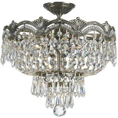 Lend a glamorous touch to your dining room or den with this elegant flush mount, showcasing hand-cut crystal accents and a silver-toned finish. ...