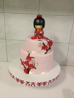 Kokeshi japanese doll cake with cherry blossom