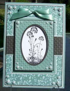 handmade greeting card ... Serene Silhouettes ... aqua, cream and dark gray ... symmetrical design ... matted layers ... pearls in the corners ... patterned paper, embossed card stock and ribbon all the same color ... like this card! ... Stampin' Up!
