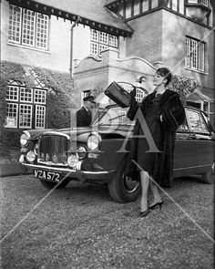 Fur Coats for November At The North Circular Road entrance to Phoenix Park, Dublin, Adrienne Ring models fur coats for McConnells.Image shows her posing alongside an Austin Princess car. Princess Car, Ireland Fashion, Irish Fashion, Fur Coats, Dublin Ireland, Photo Archive, Winter Collection, Veronica, Phoenix