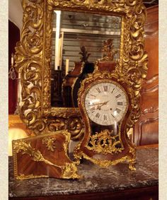 """Fine, French, Louis XV period cartel clock.  In working order with rosewood veneers and original gilt bronze mounts. Signed """"Le Bel Paris."""" Circa 1750."""