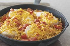 Miracle Chicken Skillet recipe    ~1/4 cup Miracle Whip   1-1/2 cups instant white rice, uncooked  1-1/2 cups 25%-less-sodium chicken broth  1 Tbsp. chili powder  4 small boneless skinless chicken breasts (1 lb./450 g)  1 tomato, chopped  1/2 cup  Old Cheddar Shredded Cheese
