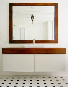 Simple, chic, not-too-modern cabinet. Ikea's Godmorgon cabinet with two drawers. Created a warm wood counter for single sink instead.