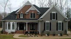 grey siding, red brick, black shutters