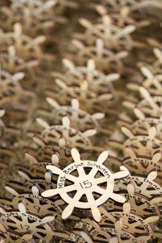 Nautical wedding idea - wooden ship wheel place cards {LAD Photography}