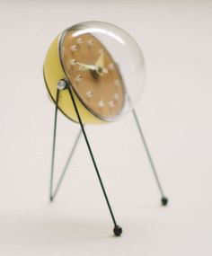 Rare 1950s Mid-century modern Table Clock, Atomic Inspired Design in the style of George Nelson. Unknown origin. Enameled steel, perspex.
