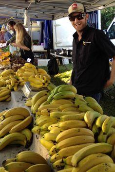 Happy banana farmer on the Noosa farmers market Australia